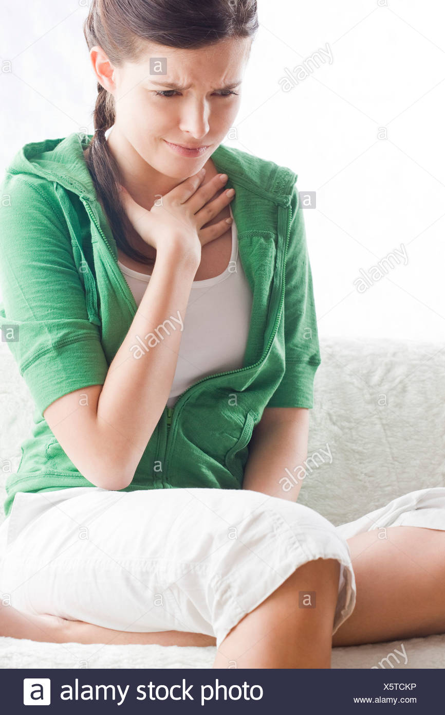 young woman feeling sick - Stock Image