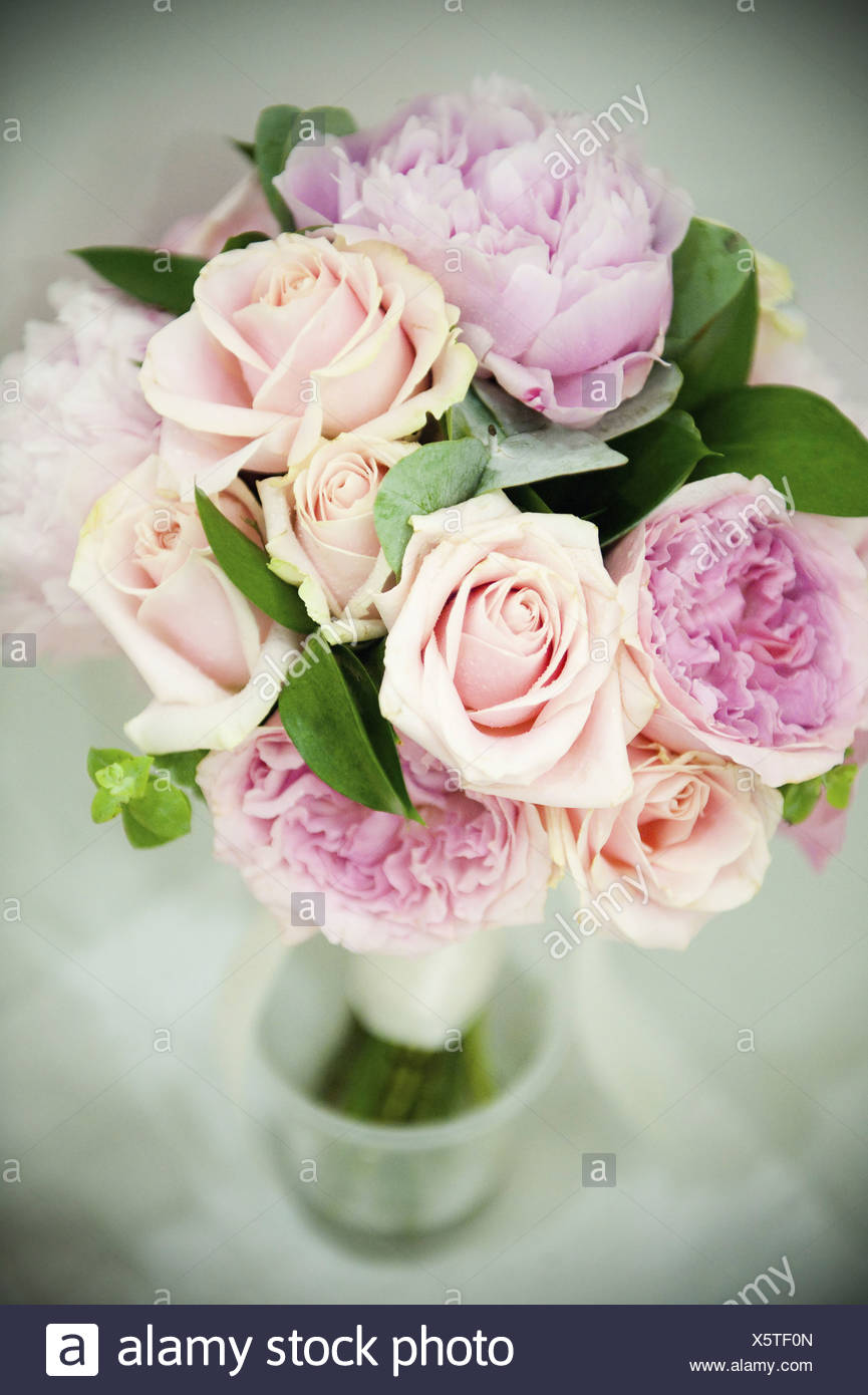 A Bridal Bouquet Of Pastel Coloured Pink Roses And Pale Lavender