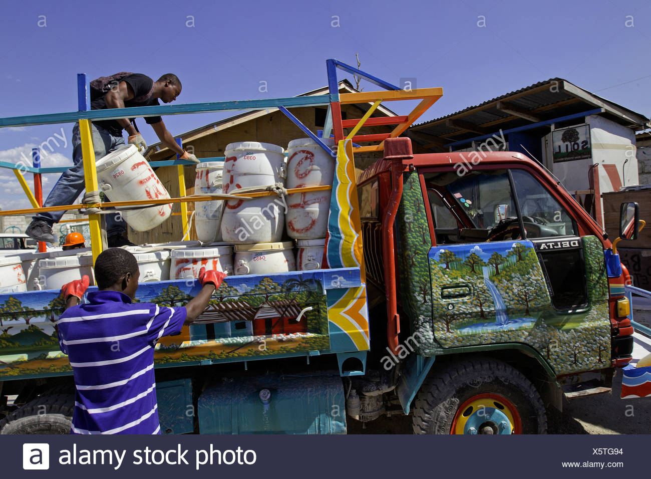 The truck known as the 'poopmobile' collects human waste from outside toilets  in Port-au-Prince, Haiti. - Stock Image