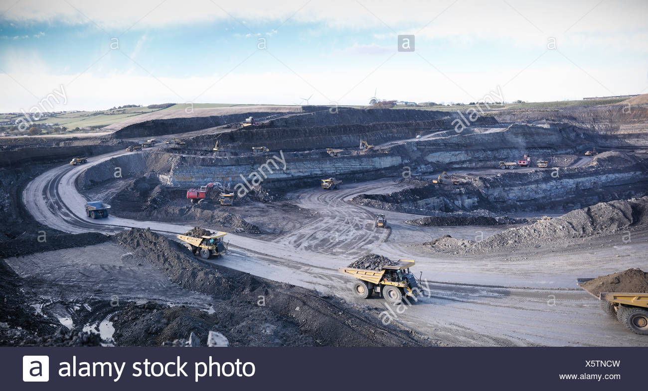 Trucks at surface coal mine site Stock Photo