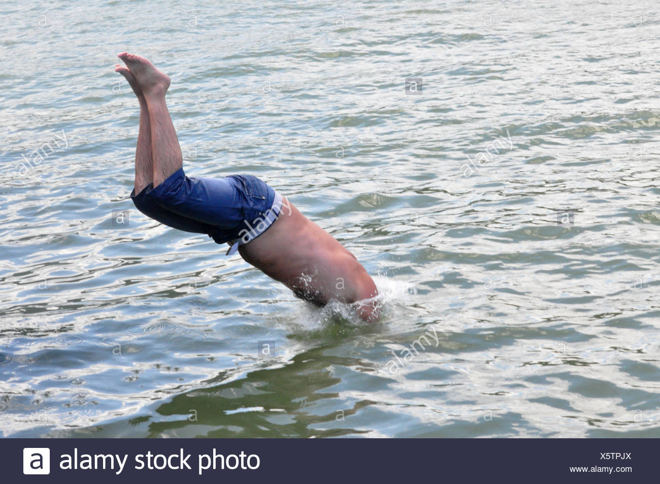 e0a62593a man plunge into water Stock Photo: 278983794 - Alamy
