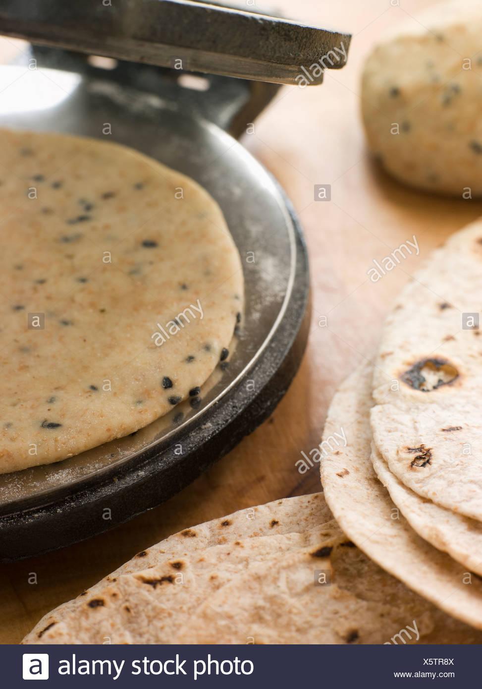 Chapatti Press with Chapatti Breads - Stock Image