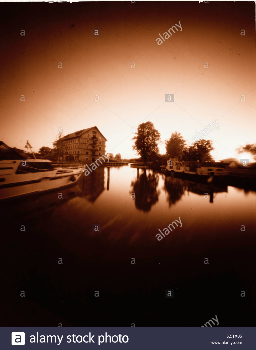 Reflection of trees and houses in lake, Lake Muritz, Mecklenburg Western Pomerania, Germany Stock Photo
