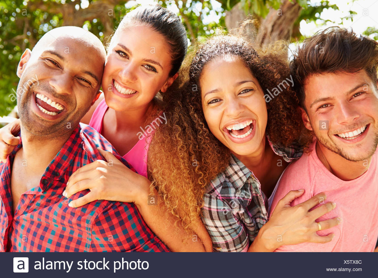 Group Of Friends Having Fun Outdoors Together - Stock Image