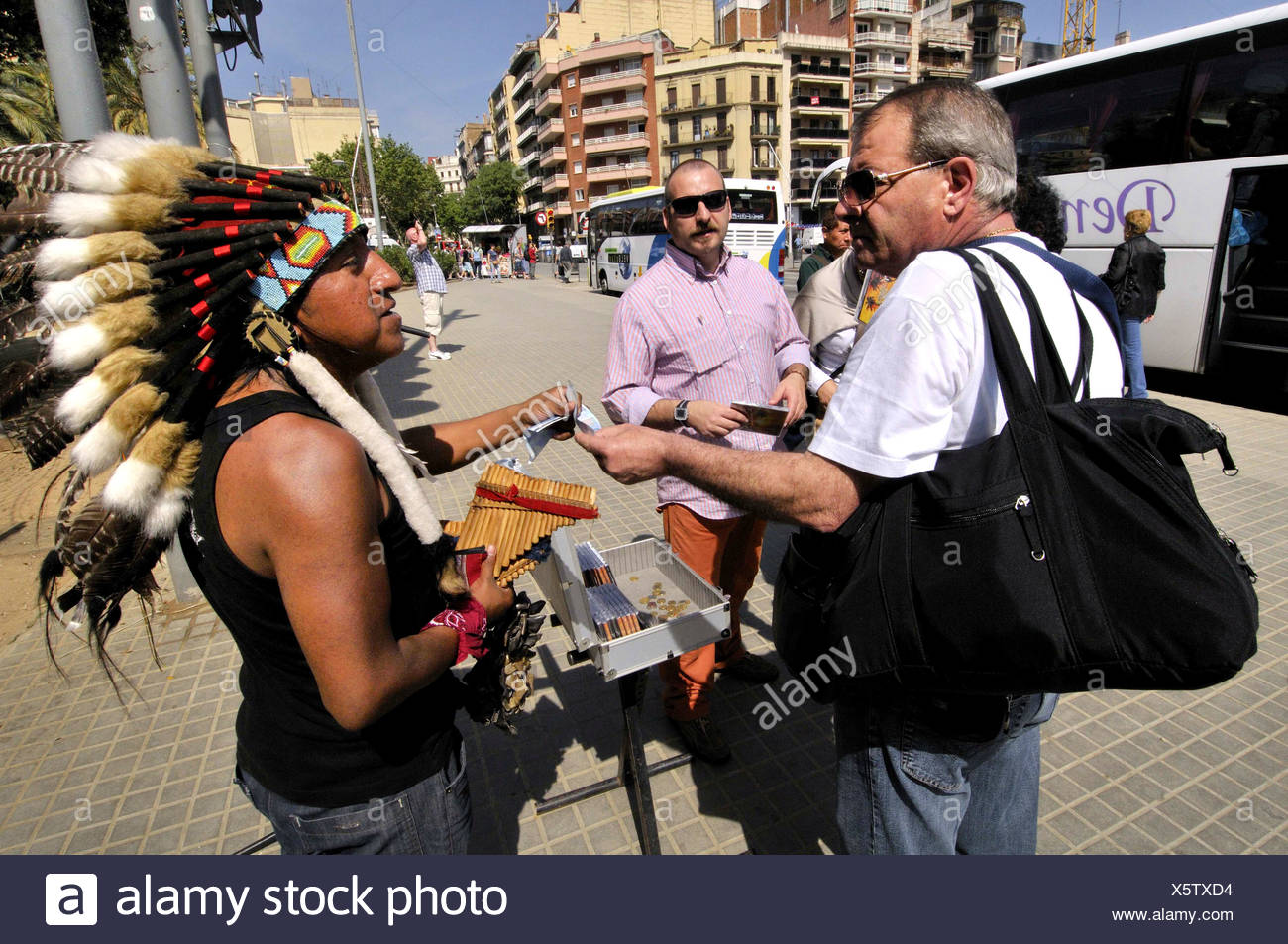 Dress Indian musician selling CD with Andean flute music  Gaudi