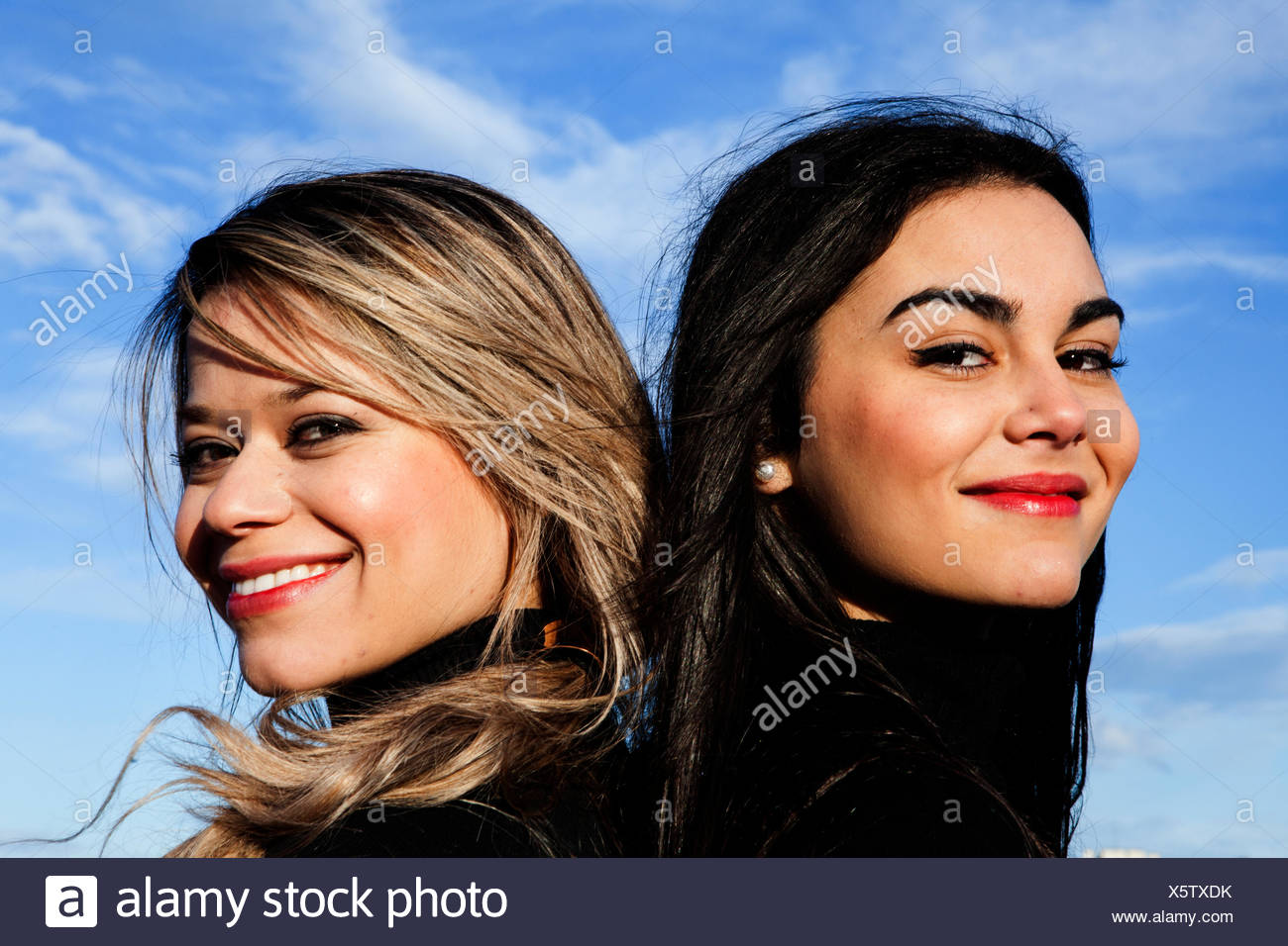 Portrait of two young women smiling - Stock Image