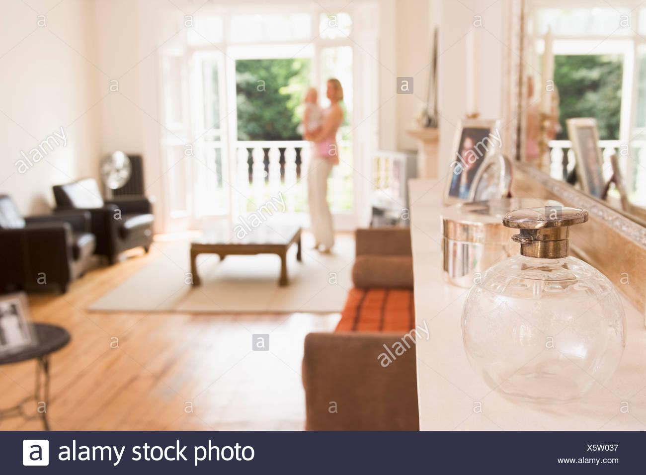 stylish nursery furniture. Woman Standing In Living Room Holding Baby - Stock Image Stylish Nursery Furniture M
