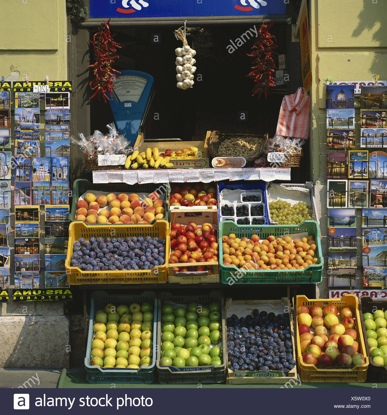 Hungary, Budapest, business, sales, fruit, postcards, Europe, capital, economy, sell, fruits, apples, apricots, nectarines, plums, grapes, postcards - Stock Image