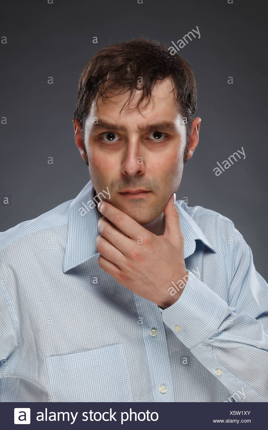 Portrait of critical man, studio shot - Stock Image