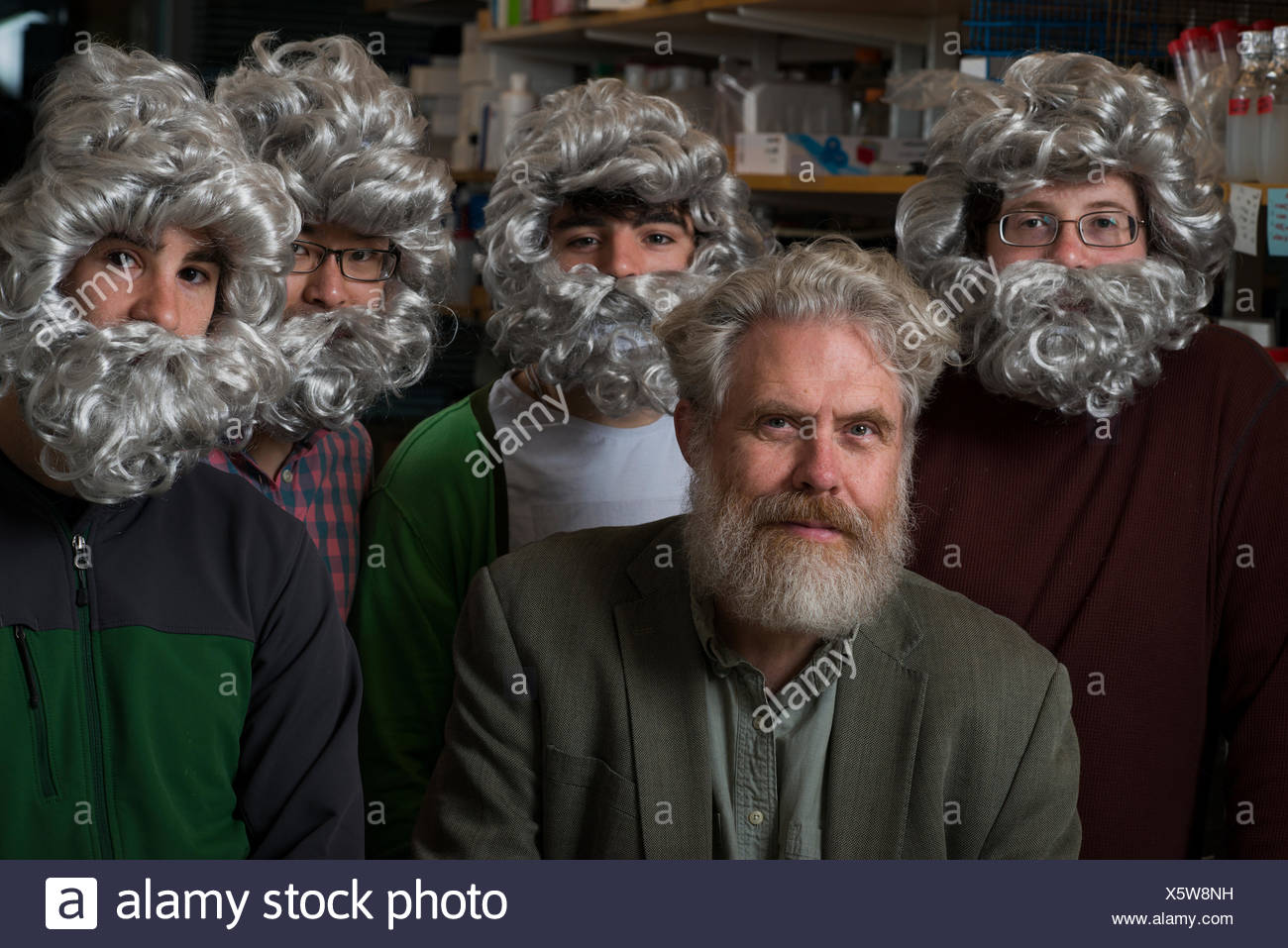 Initiator of The Human Genome Project, Dr. George Church, with post-graduate students who work in his lab, jokingly wearing beards and hair like their professor. Stock Photo