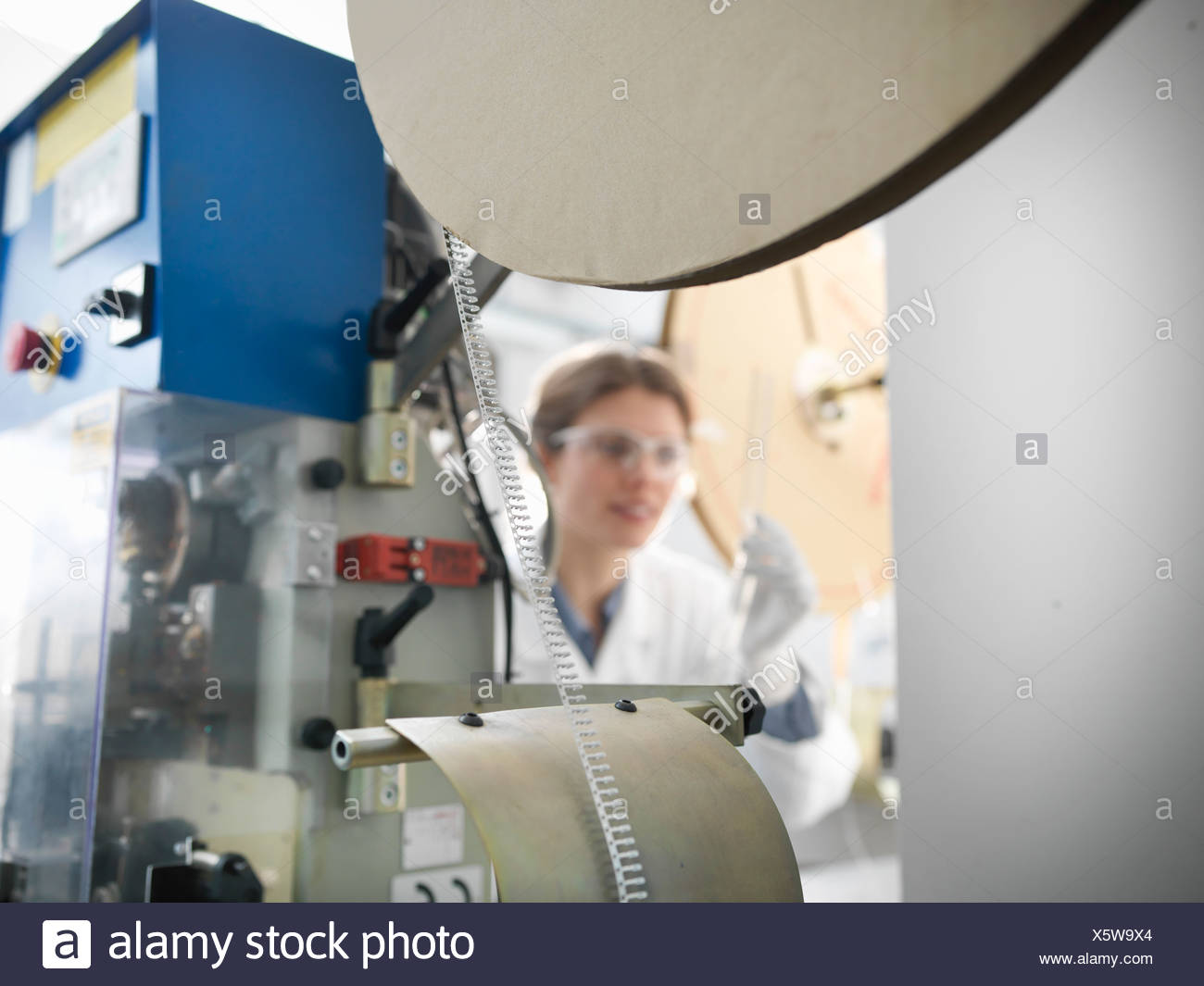 Worker with electronic component machine - Stock Image