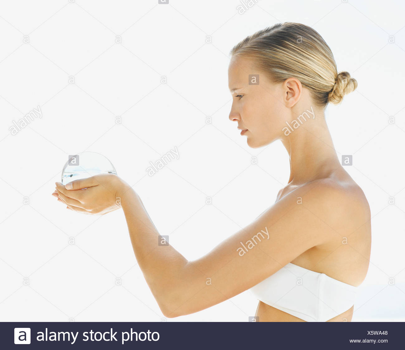 Woman holding an orb in her hands - Stock Image