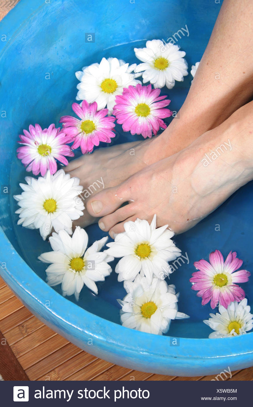 Released woman feet warm soak at health spa - Stock Image