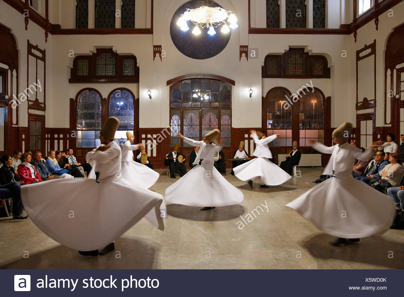 Whirling Dervishes dancing the Sema, a Dervish dance, Sirkeci Railway Station, Istanbul, Turkey, Europe, Istanbul - Stock Image