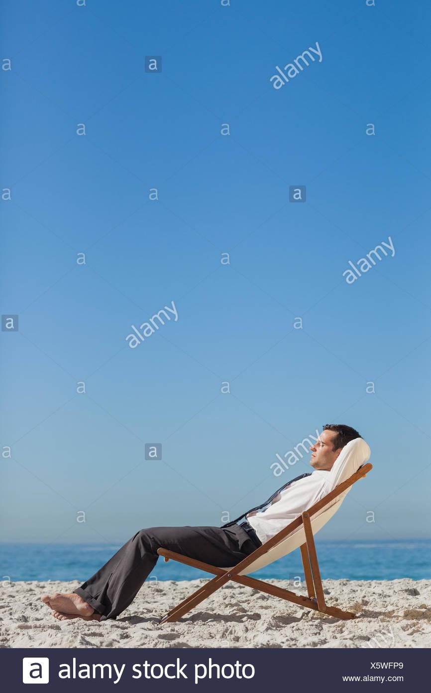 491ffd936c Businessman Relaxing Barefoot On Beach Stock Photos & Businessman ...