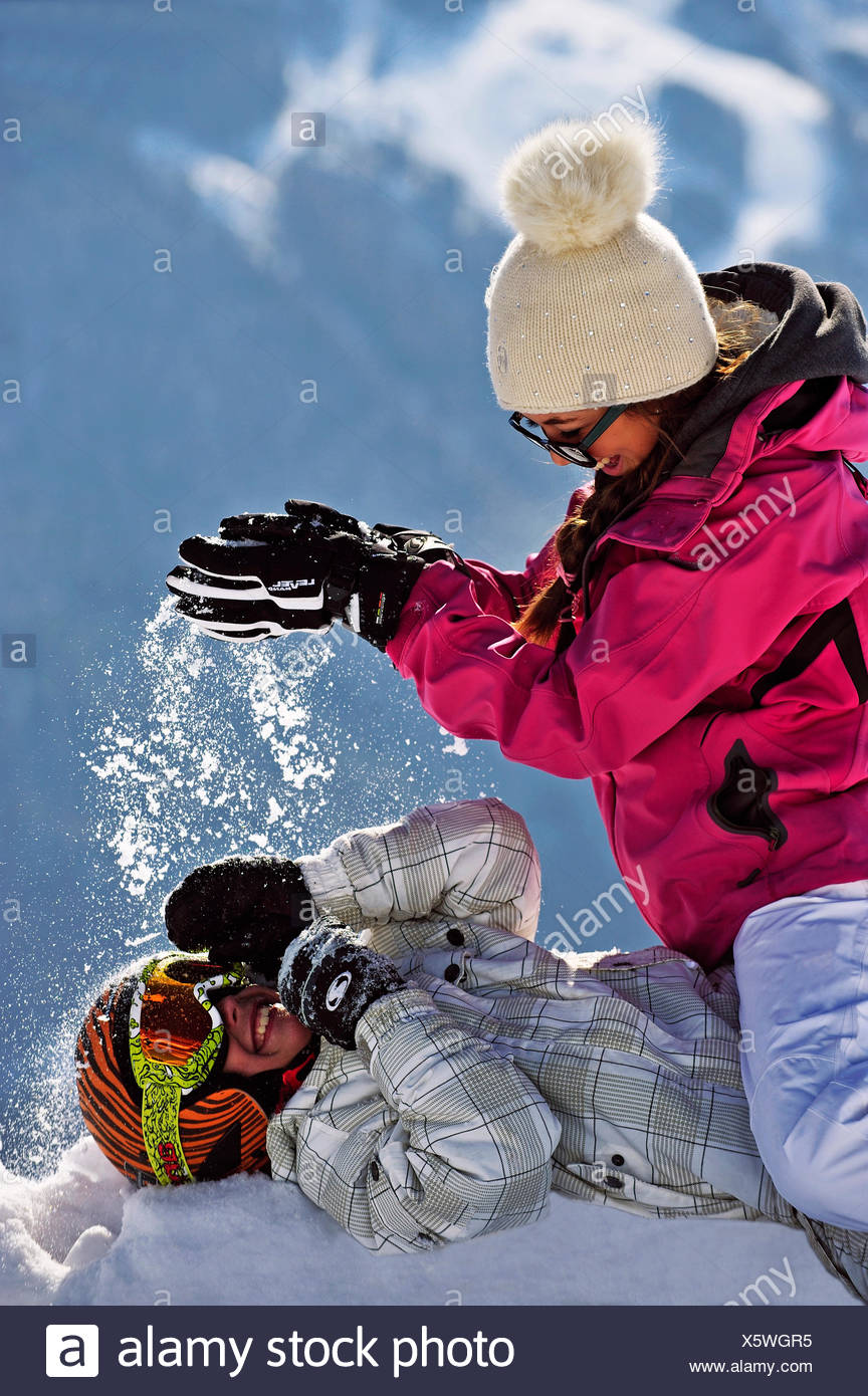 two teenagers doing a snowball fight, France - Stock Image