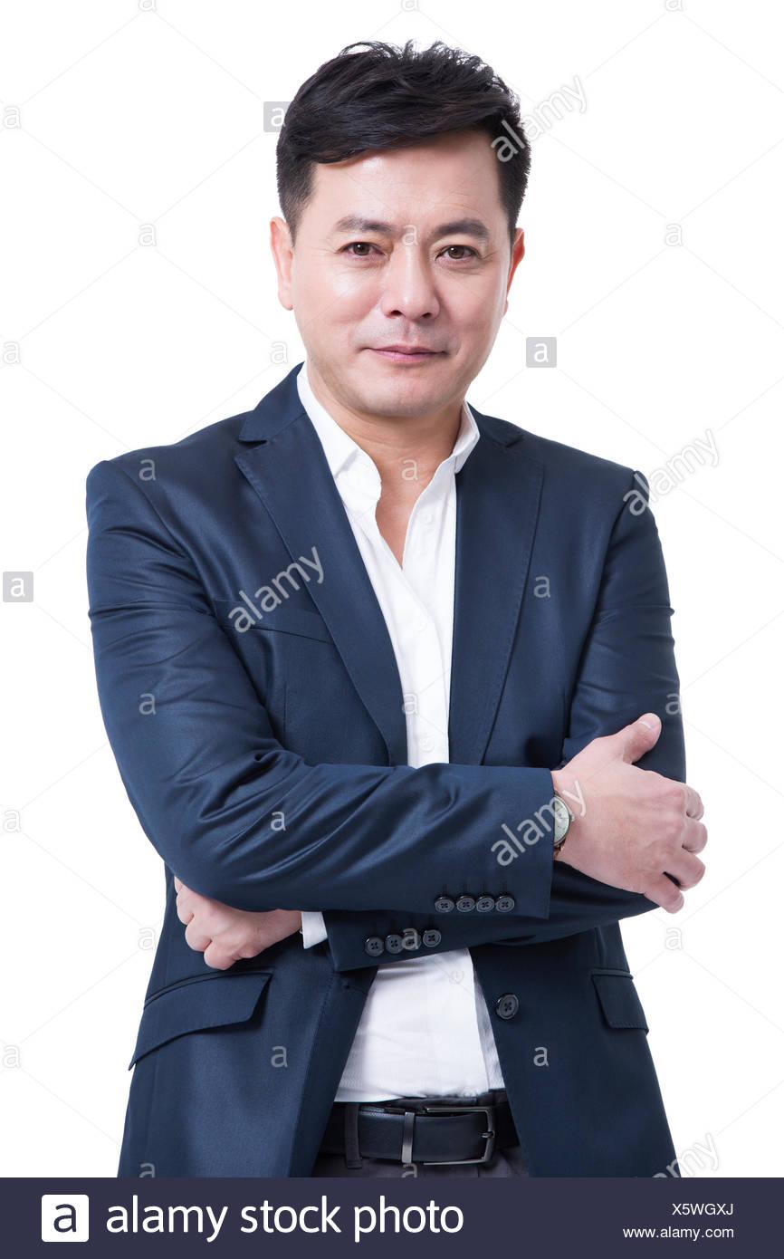 Portrait of mature businessman - Stock Image