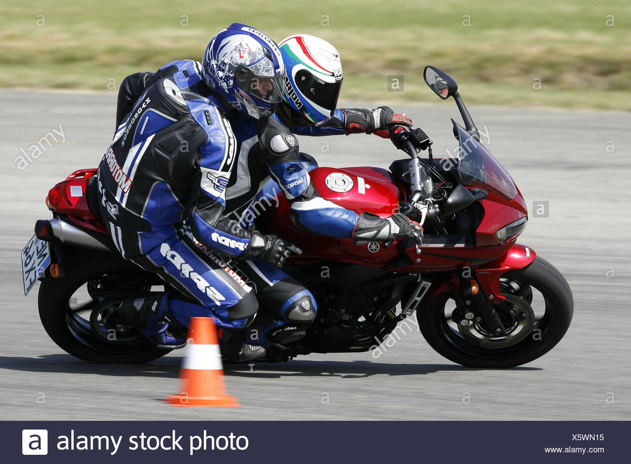 Motorcycle, Yamaha, moving, test situation, front seat passenger - Stock Image