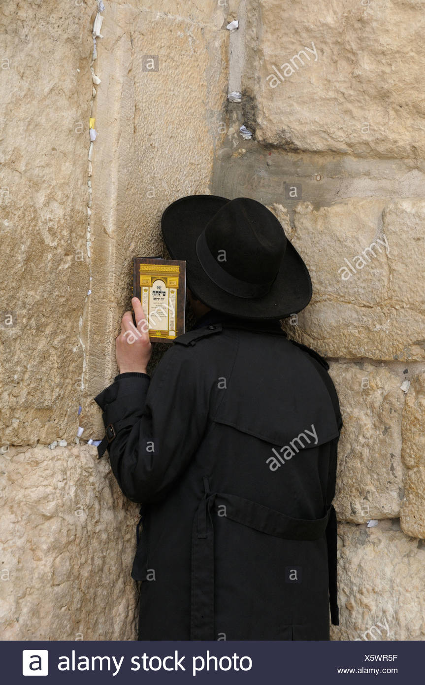Orthodox Jew praying, Western Wall or Wailing Wall, Jerusalem, Israel, Middle East - Stock Image
