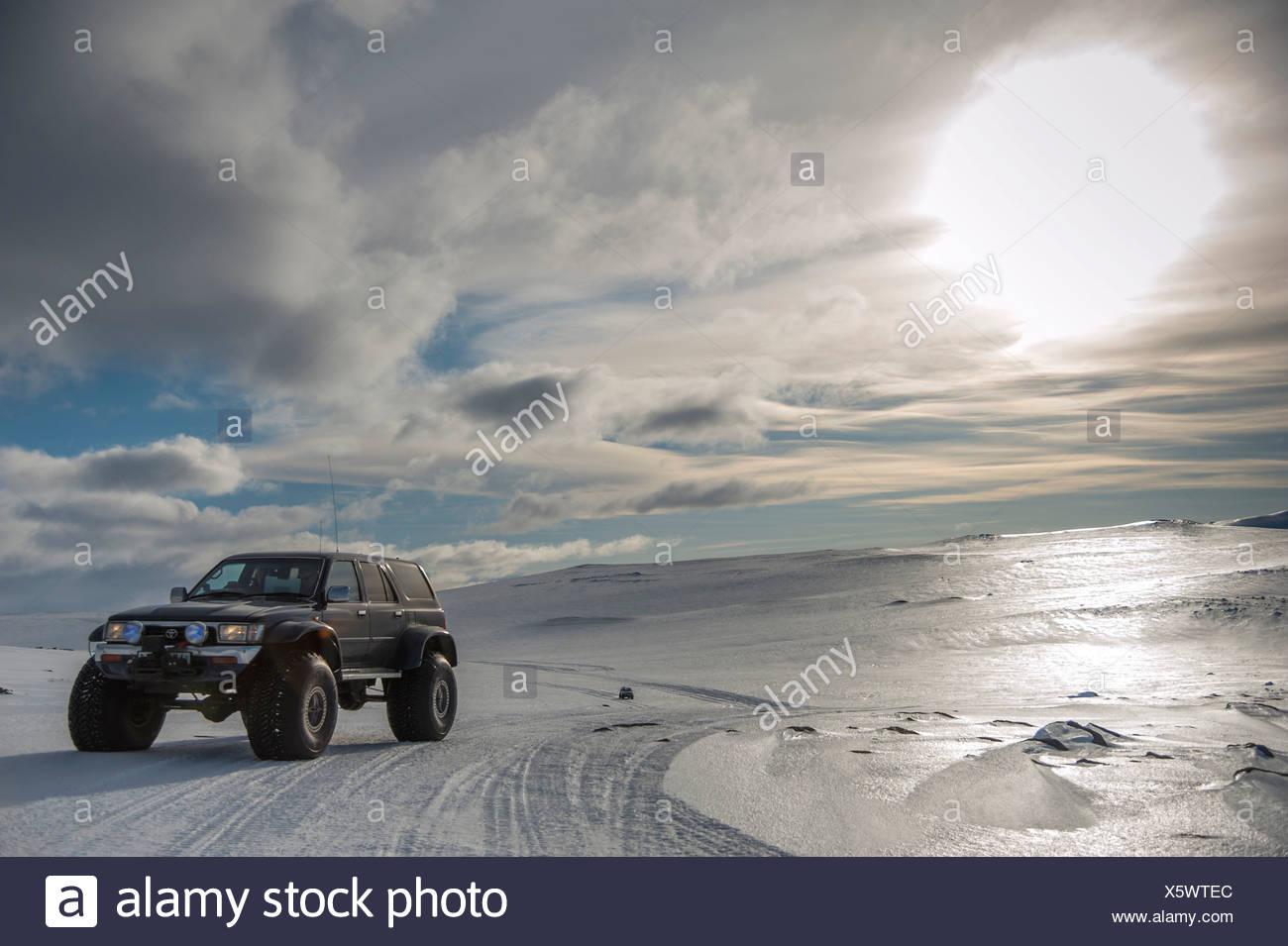 Super Jeep in a winter landscape, tyre tracks, Vatnajoekull Glacier, Icelandic Highlands, Iceland, Europe - Stock Image