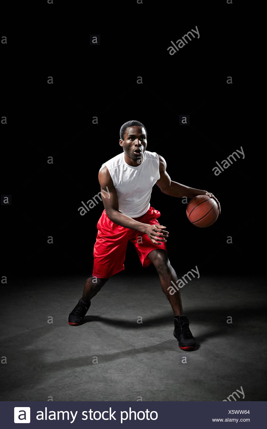 Basketball player preparing to shoot ball - Stock Image