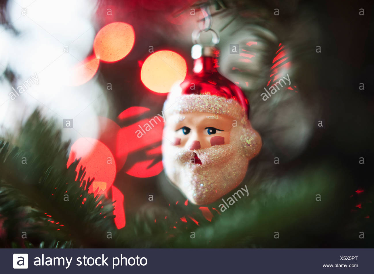 Santa Claus Christmas decoration hanging on Christmas tree, studio shot - Stock Image