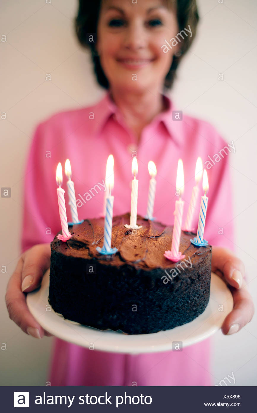 Birthday Cake Woman Carrying A With Lit Candles