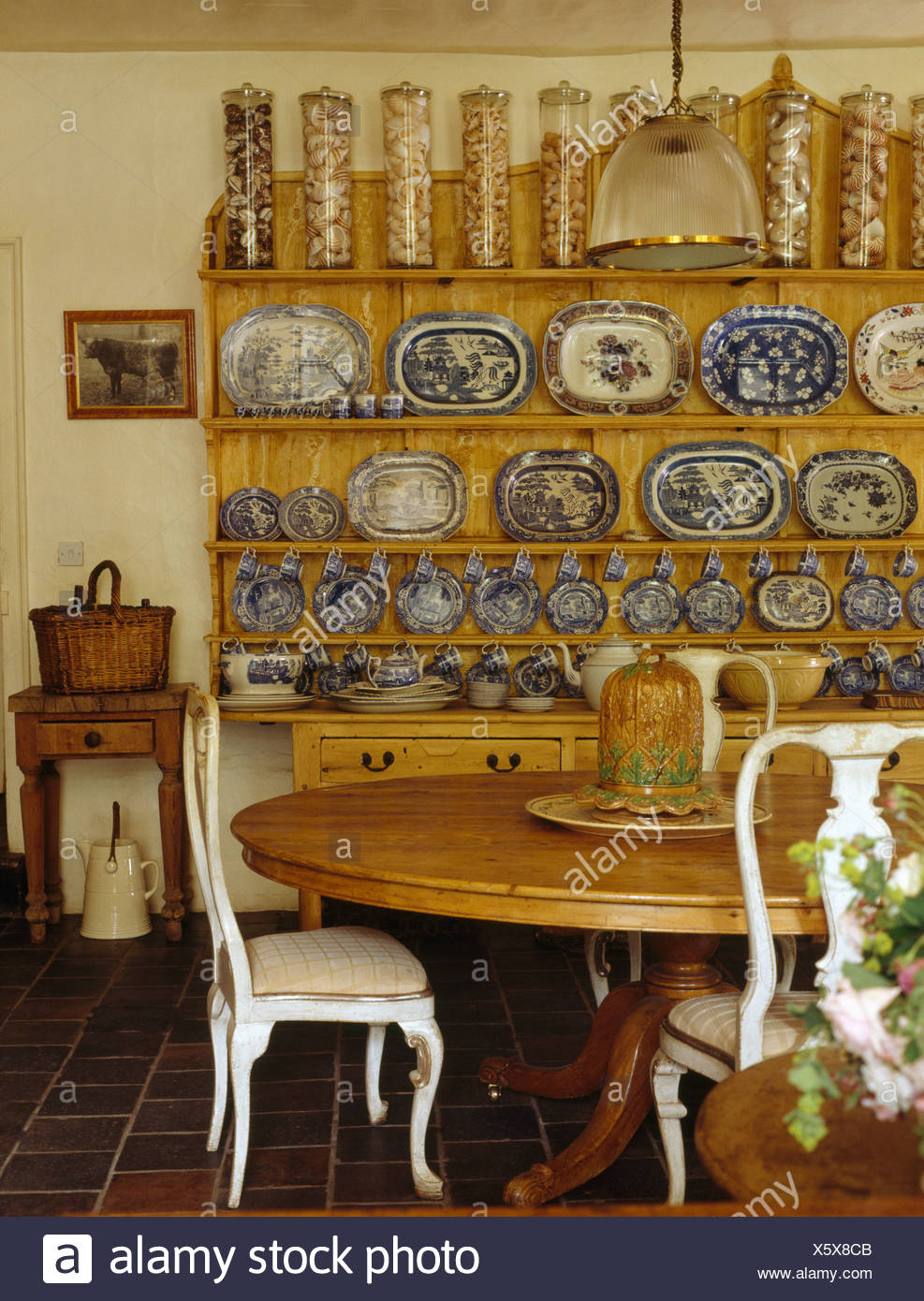 Glass Storage Jars And Blue White Plate Collection On Dresser In Victorian Style Dining