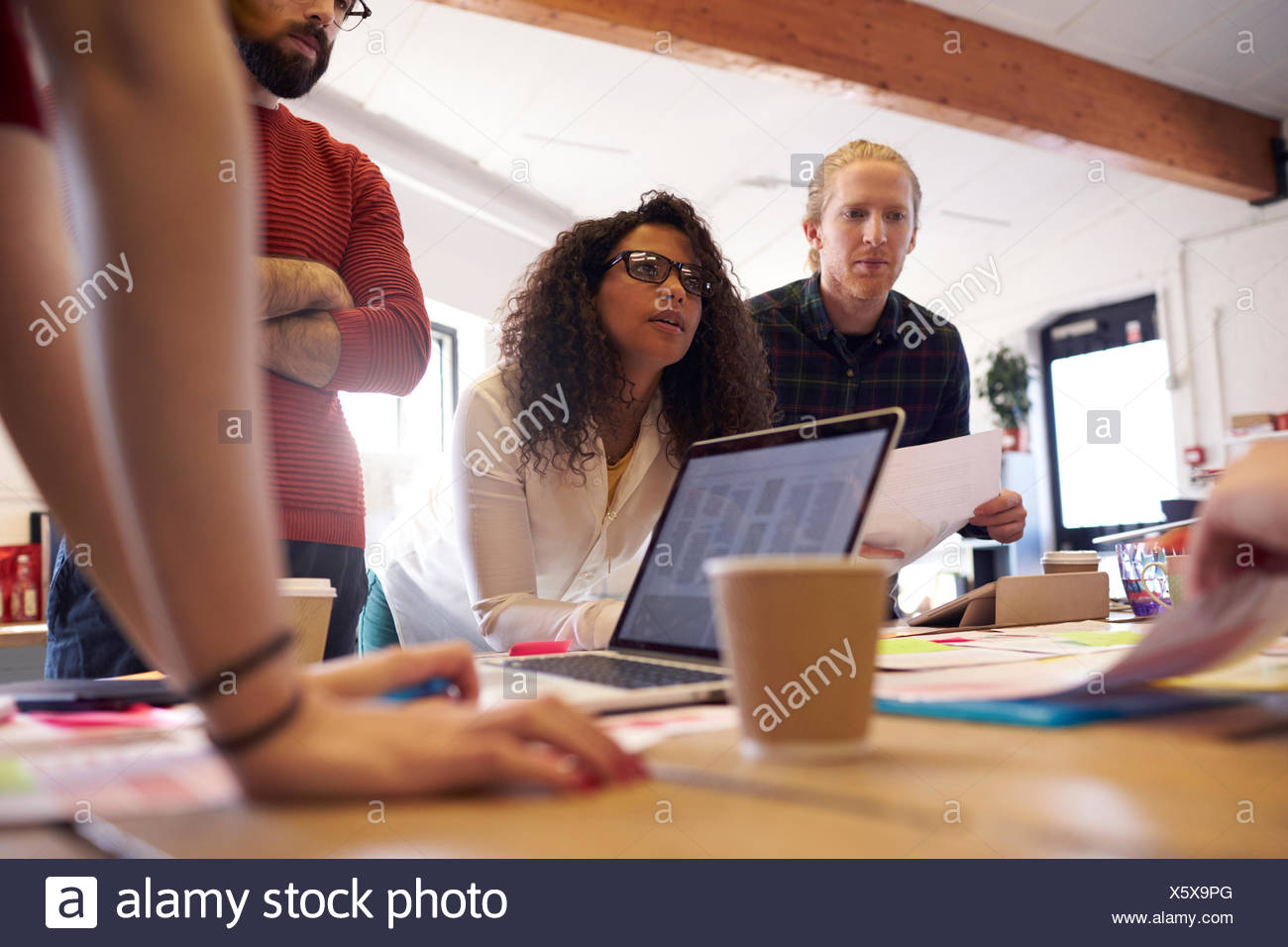 Low Angle View Of Creative Brainstorming Meeting In Office - Stock Image