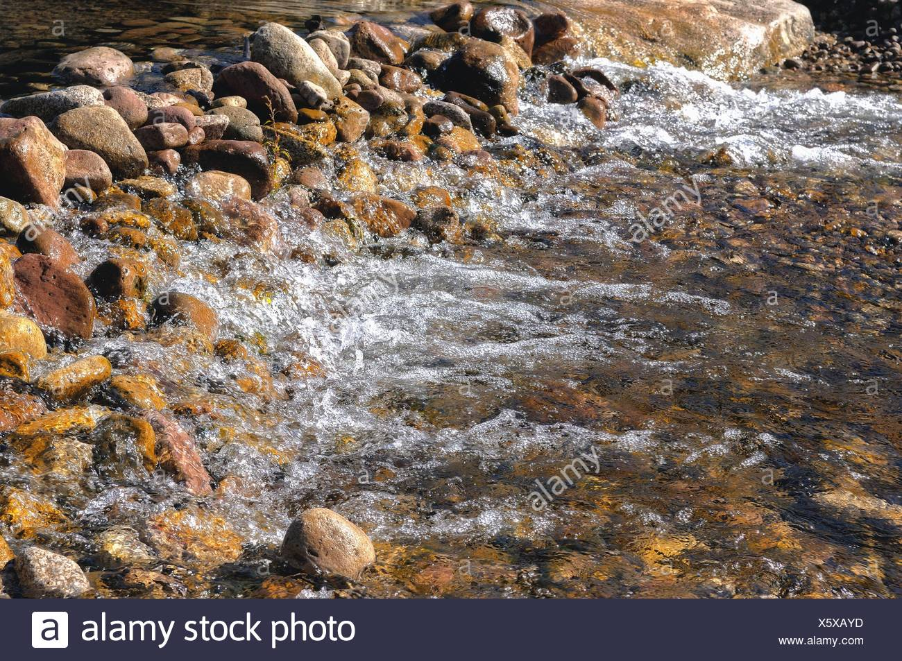 jammed and yet permeable to the stone embankment Stock Photo