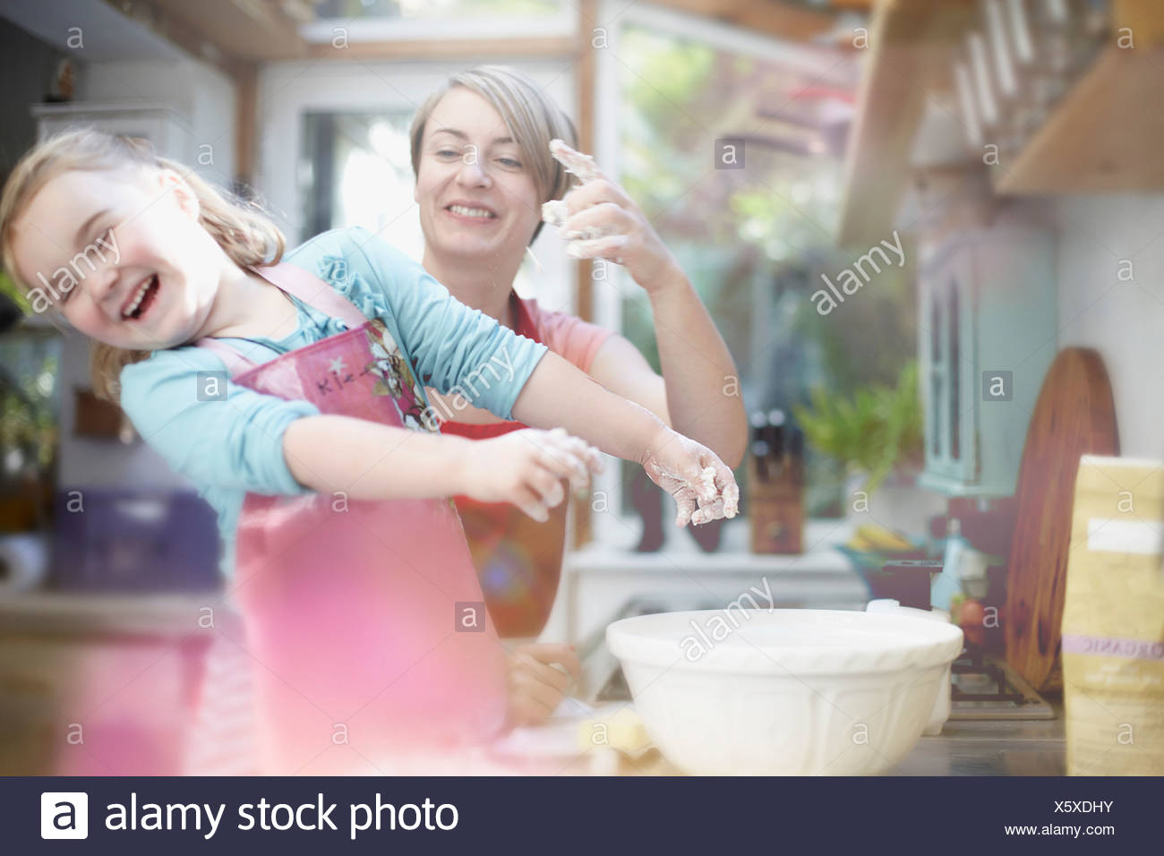 Mother and daughter baking together - Stock Image