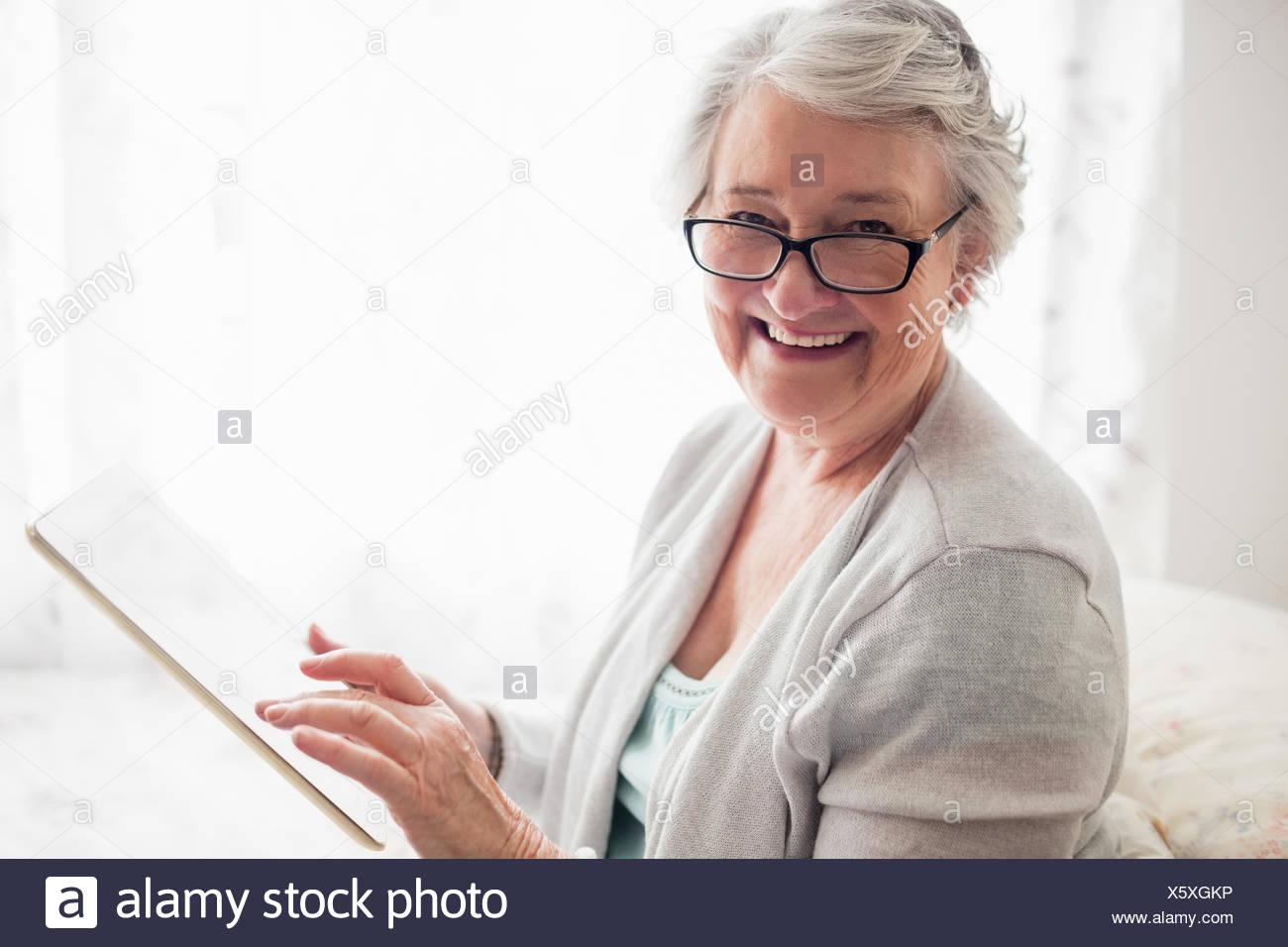 Senior woman smiling - Stock Image