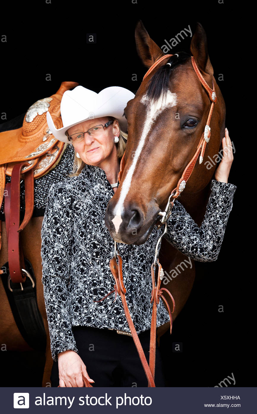 Quarter Horse, bay gelding, tournament outfit with a female Western rider, at a Wild West Show - Stock Image