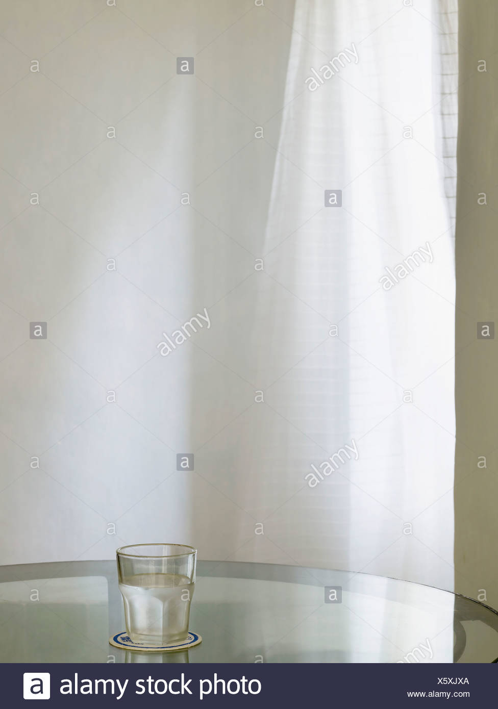 Drinking Glass Full of Water - Stock Image