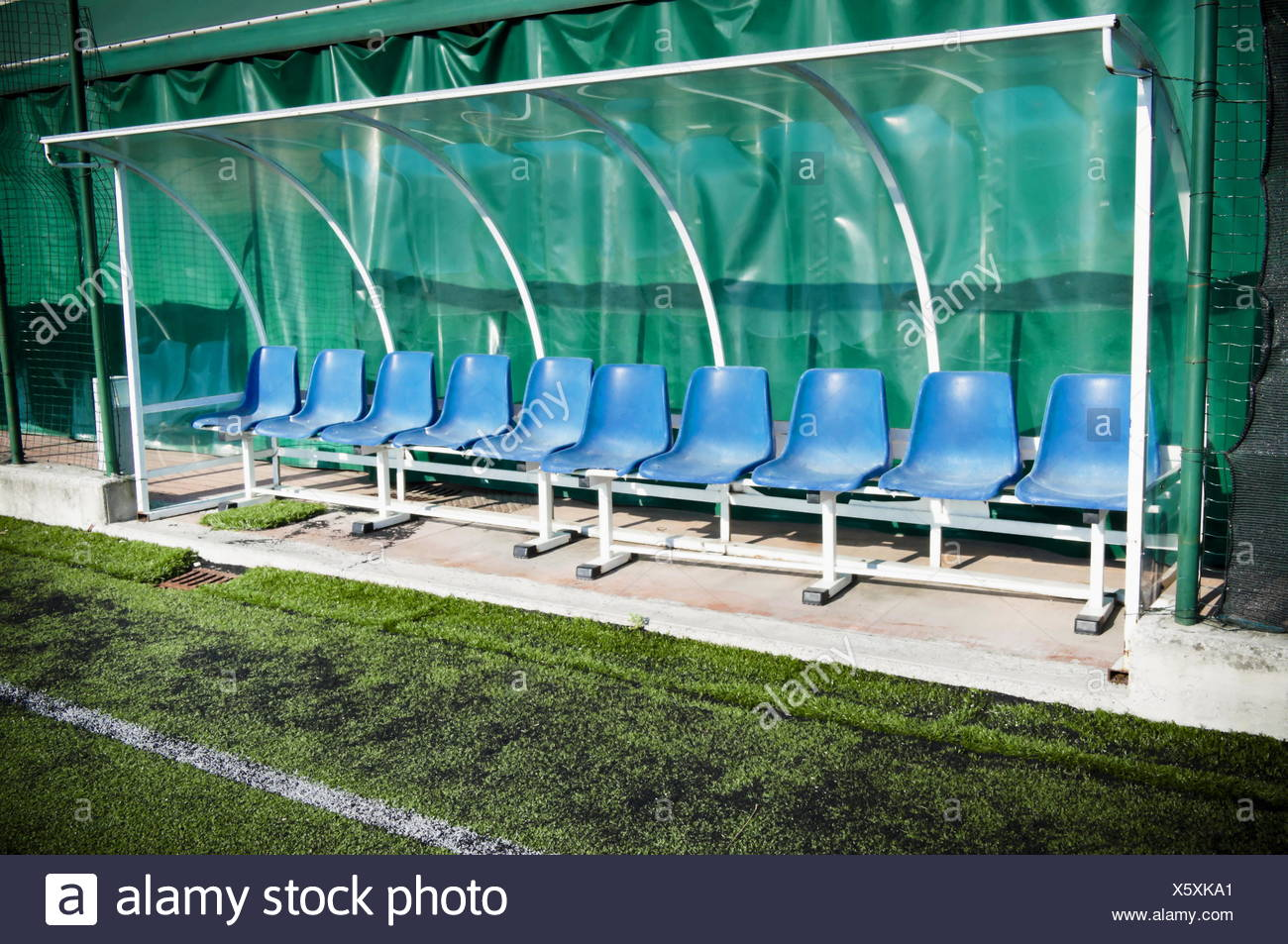Coach and reserve benches in a soccer field - Stock Image