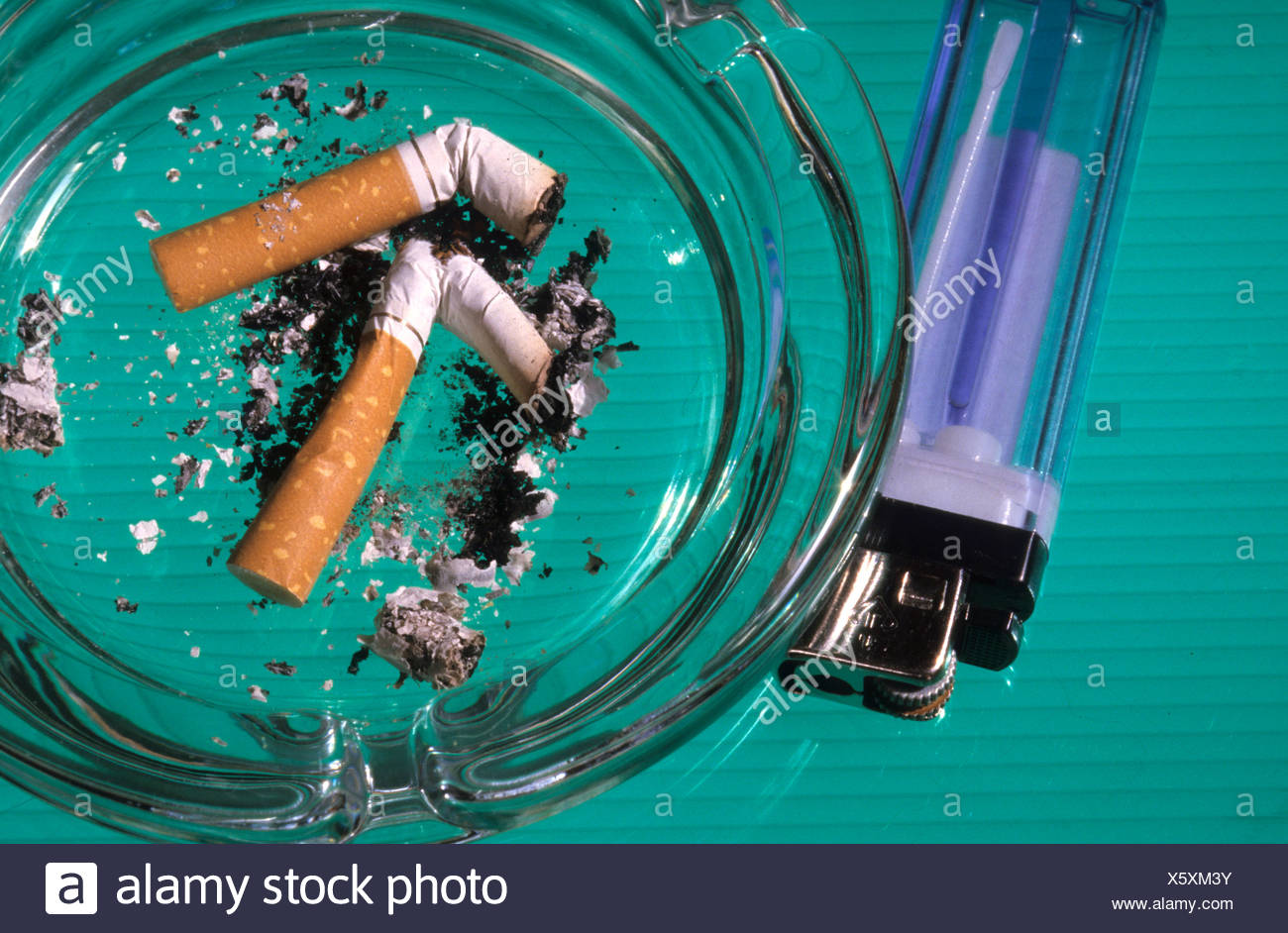 Disposable lighter and ashtray. - Stock Image