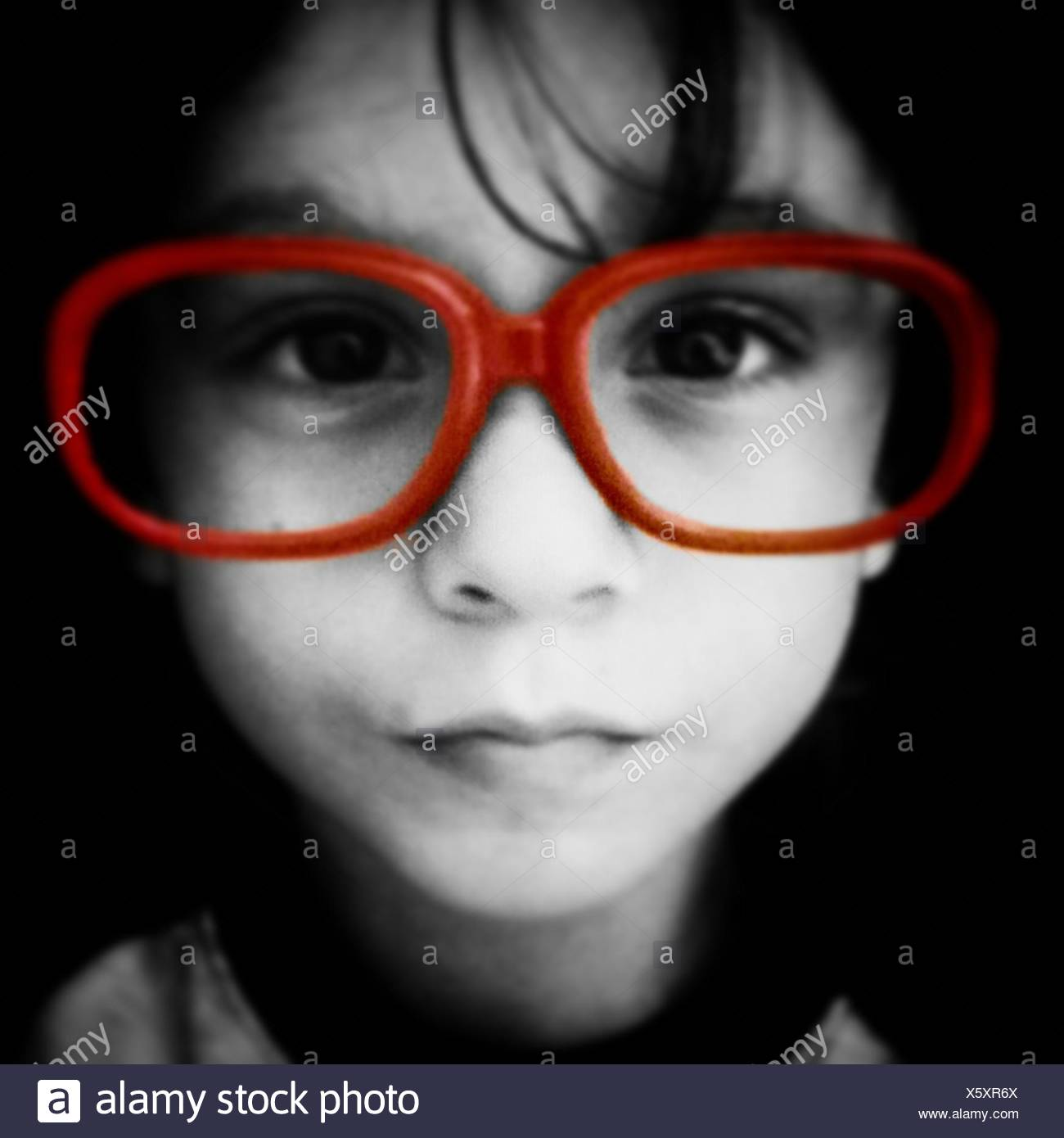 Boy Wearing Large Red Rimmed Eyeglasses - Stock Image