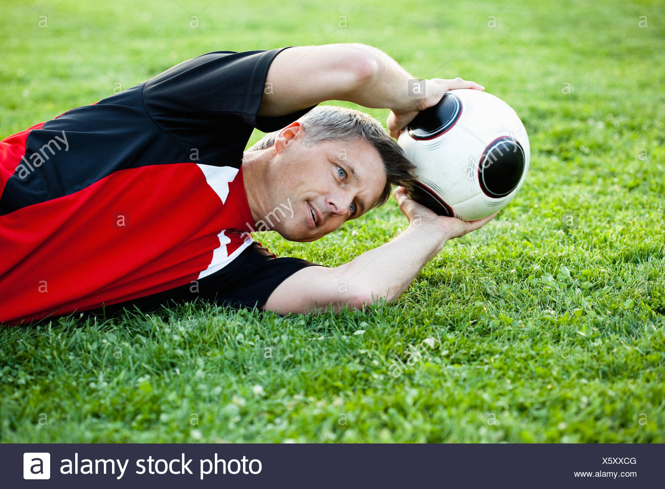 Goalkeeper Saves Ball - Stock Image