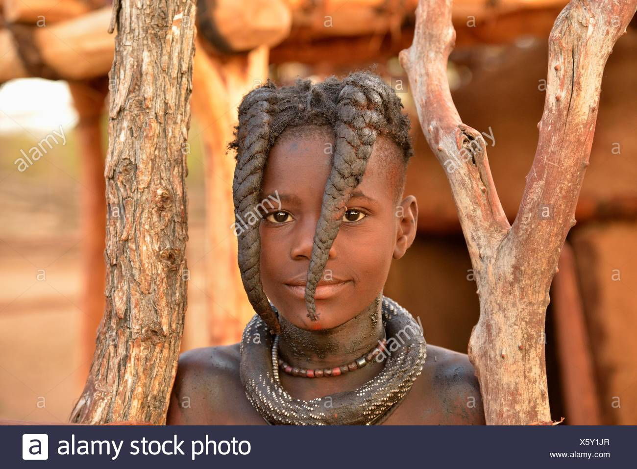 Himba girl with typical hairstyle, Omuramba, Kaokoland, Kunene, Namibia - Stock Image
