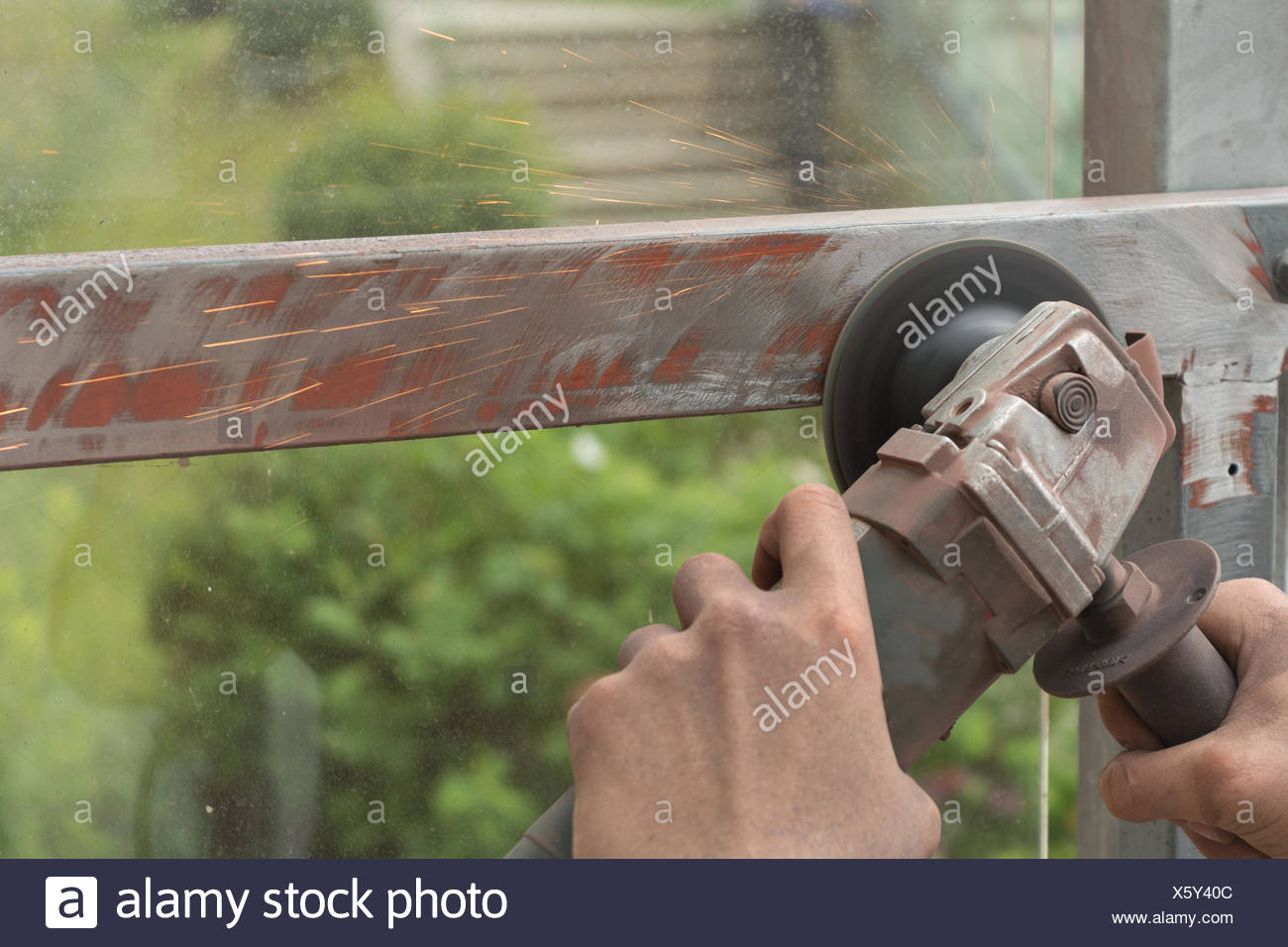 Metalworking with angle grinder - Stock Image