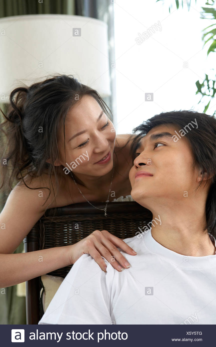 Young Couple Smiling At Each Other - Stock Image