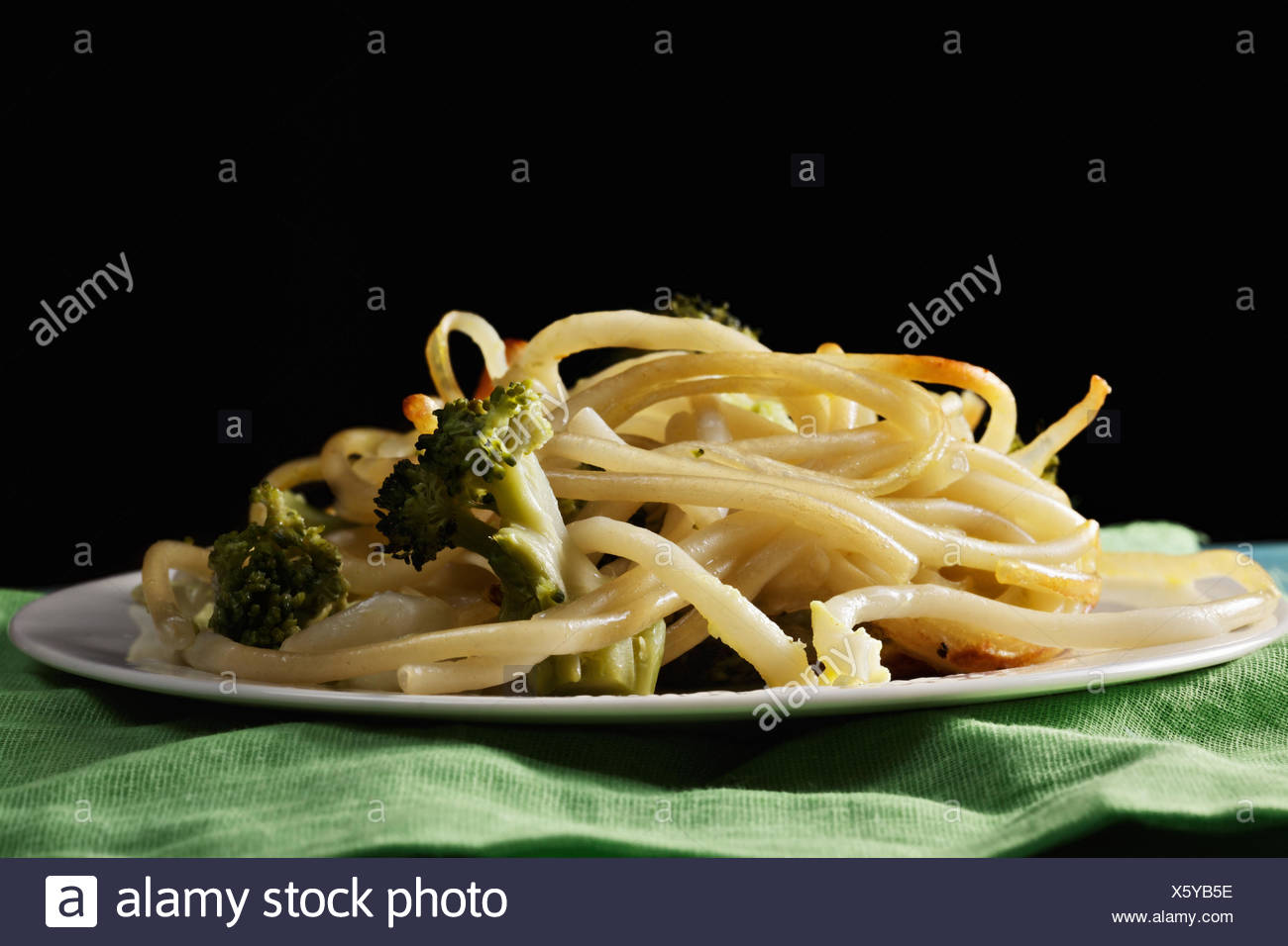 Pasta with broccoli in darkness - Stock Image