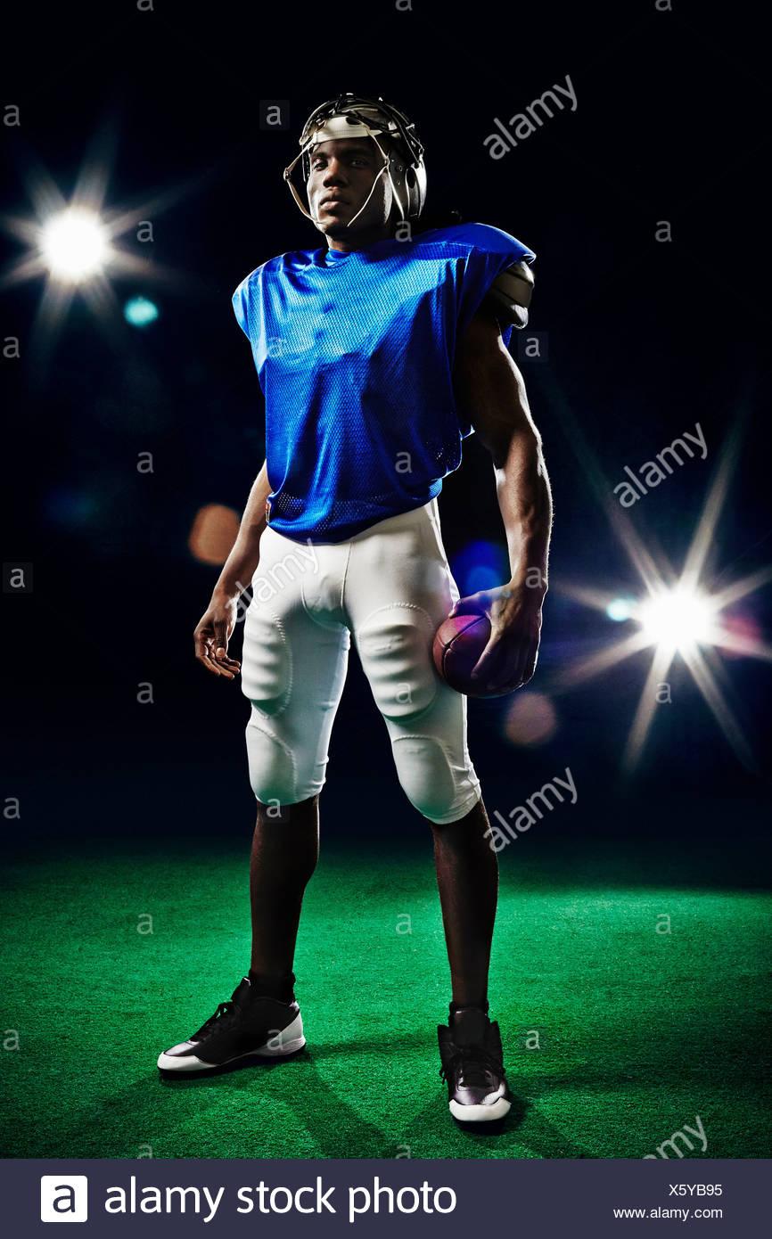 Full length portrait of american football player - Stock Image