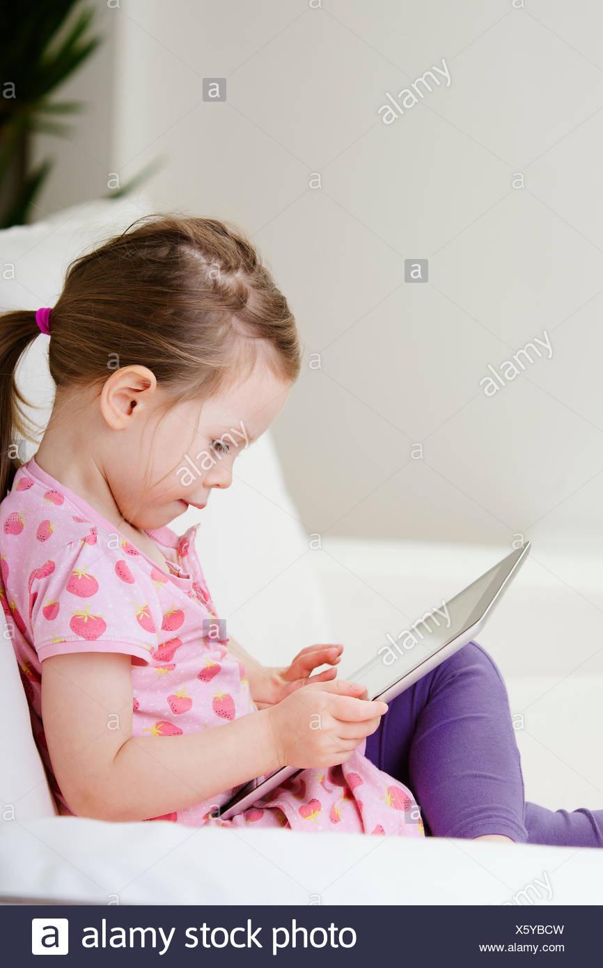 Sweden, Girl (2-3) using digital tablet - Stock Image