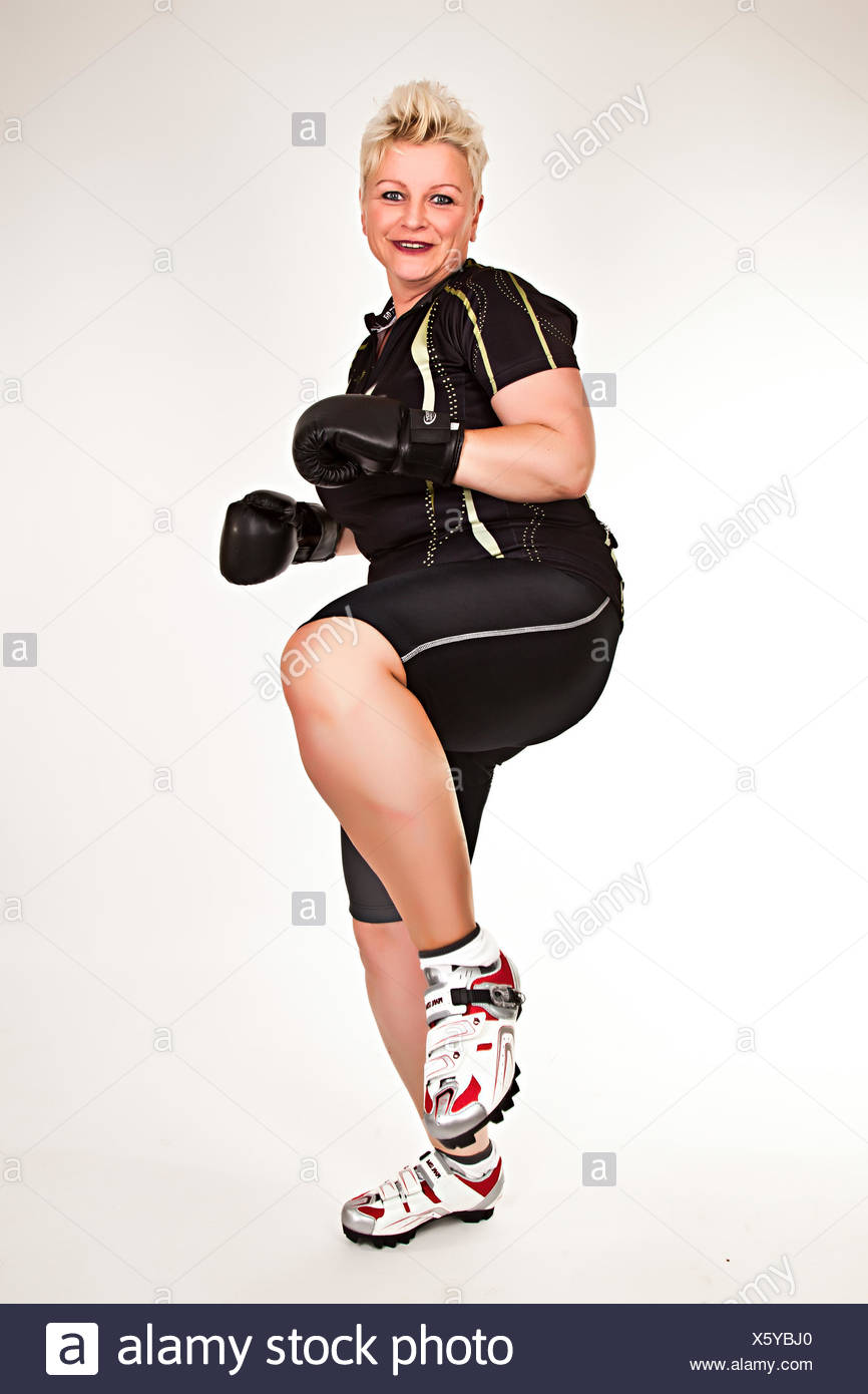 middelaged fitness woman boxing wearing boxing gloves and having fun Stock Photo
