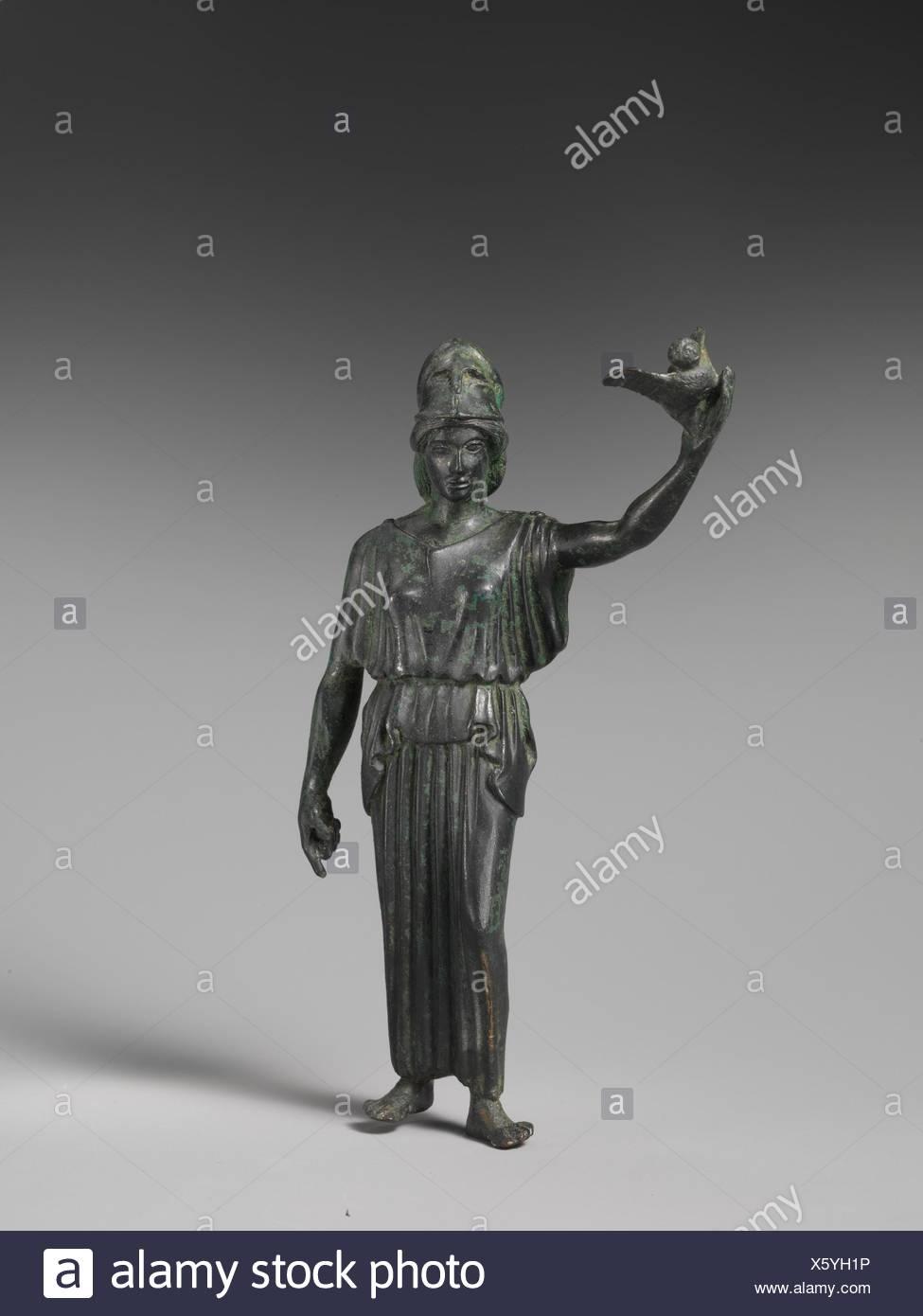 Bronze statuette of Athena flying her owl. Period: Classical; Date: ca. 460 B.C; Culture: Greek; Medium: Bronze; Dimensions: H. 5 15/16 in. (15 cm); - Stock Image