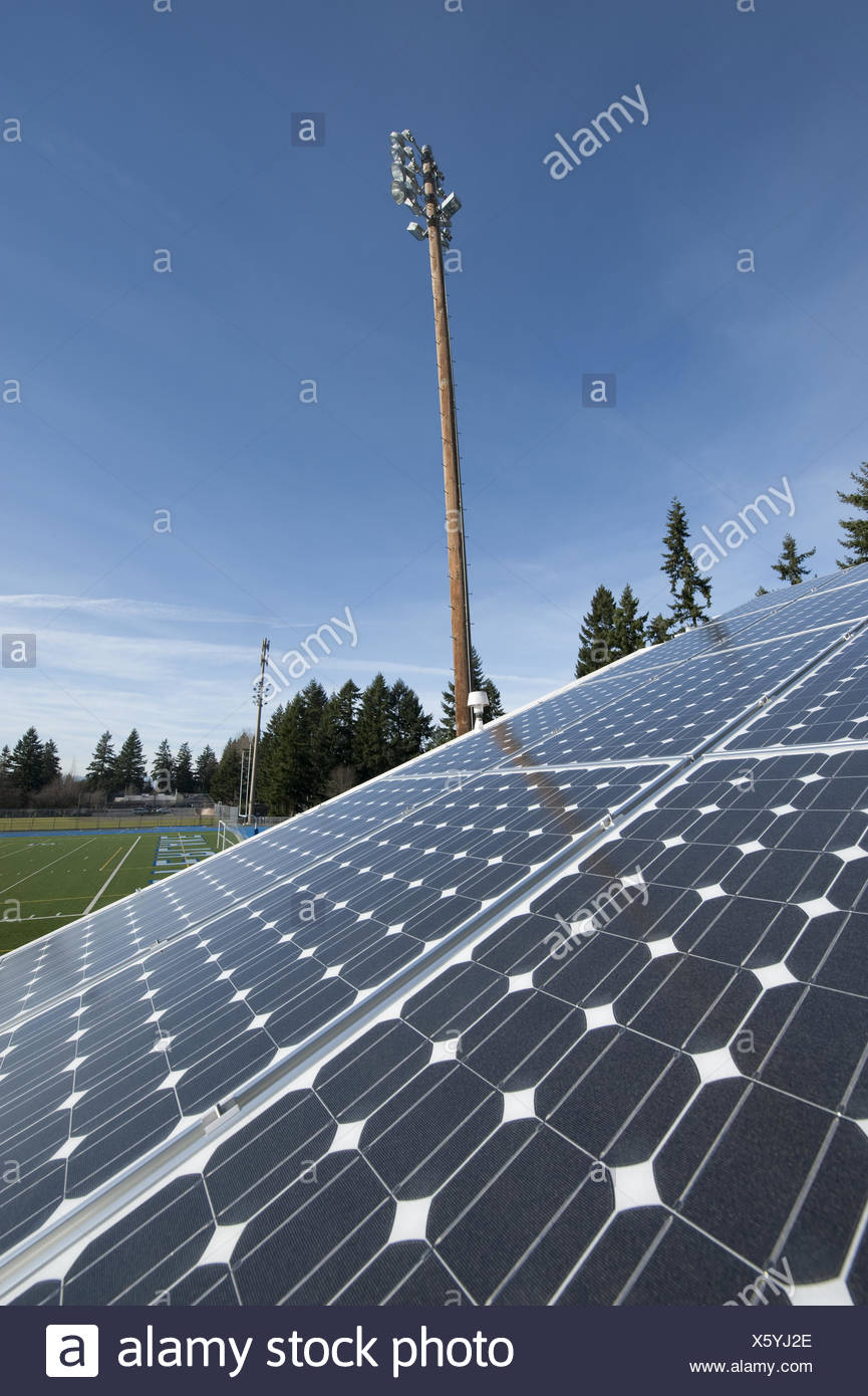Photovoltaic panels on a roof - Stock Image