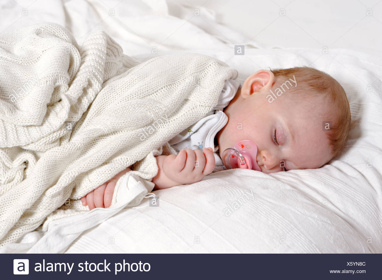 Baby, 6 months, sleeping with a dummy - Stock Image