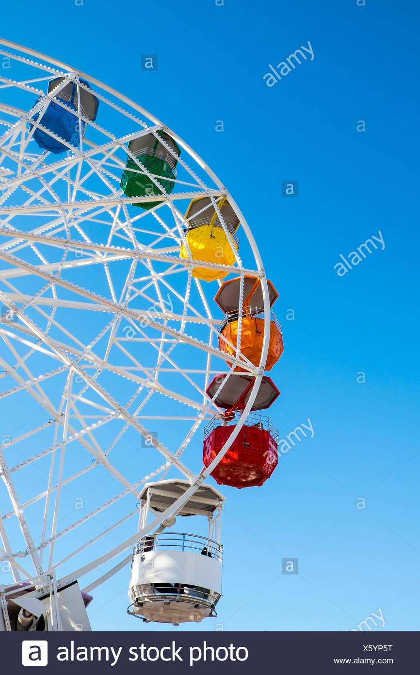 Detail of a colorful ferris wheel seen on a fair - Stock Image