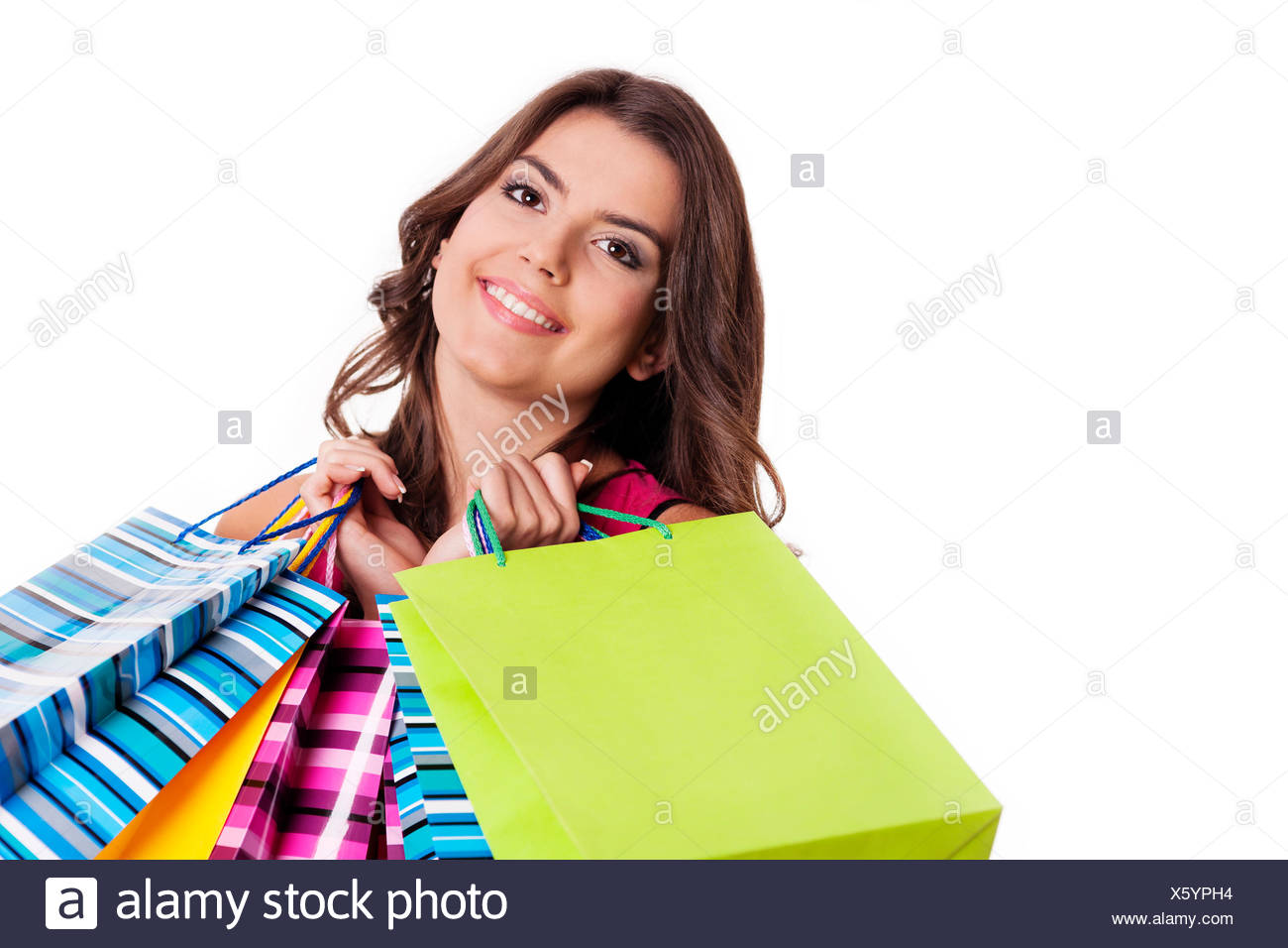 Brunette woman with multi colored shopping bags, Debica, Poland - Stock Image